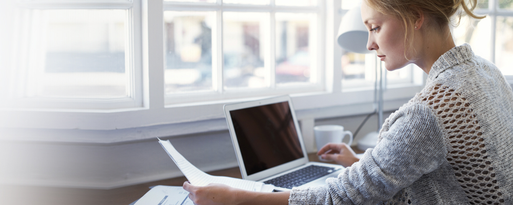 Student taking webinar on laptop