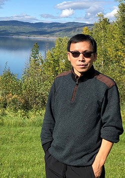 Dr. Adam Wei, professor of earth, environmental and geographic sciences, visits the Williston Reservoir near Fort St. John, BC.